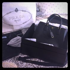 💕1HOUR SALE💕Prada Saffiano LUX 100% authentic BRAND NEW NEVER USED PERFECT CONDITION NEVER TAKEN OUT OF THE BOX 100% authentic guarantee purchased in prada Rome in June 2015. Do not ask a million times if it is authentic it is GUARANTEED. Listing includes the bag, silk dust bag, prada box, authenticity card, and detachable strap with dust bag. I am in NO rush to sell so do not low ball. 🚫I AM NOT TRADING BE RESPECTFUL AND PLEASE DO NOT ASK🚫USE OFFER BUTTON. RUDE COMMENTS WILL GET YOU…
