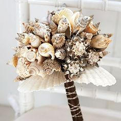 Beach wedding. I think some would like the natural shells, but if it were me I might spray paint them gold