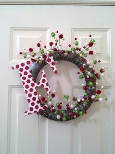 DYI Christmas Wreath. I would cover up the foam wreath with ribbon.