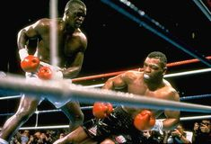 Top 15 KOs in boxing history Buster Douglas Mike Tyson, Sports Illustrated, Eric Cantoná, Once Were Warriors, Ricky Hatton, Marvelous Marvin Hagler, Boxing History, Joe Louis, Champions Of The World