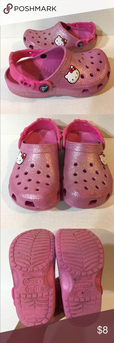 Girls Hello Kitty Crocs Sparkly Pink Hello Kitty Crocs in good condition. These are perfect as house shoes or water shoes. Cleaning needed as they have been in storage & Slight scratches see pictures. CROCS Shoes Water Shoes