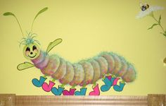 """This is """"Willy the Joyful Worm"""" painted in the Children's Shop at the Broadmoor Resort in Colorado Springs by Mickey Baxter-Spade. Willie is nearly 30"""" long."""