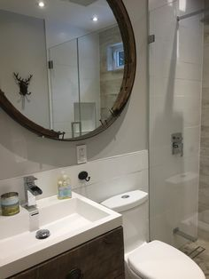Top-Notch Renos - Cottage bathroom with barn board tile wall, mosaic pebble tile heated floor. glass shower doors, round mirror, vanity with barn board face and antique handles.