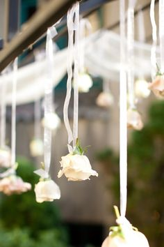 Hang roses (silk from the Dollar Tree) and cherubs from ribbons (tulle is much cheaper, actually) at varying lengths in a row over the Sweetheart table