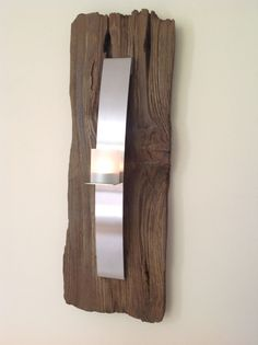"Houten wandpaneel met rvs kaarsenhouder.  Wooden wall decoration with stainless steel candle holder. Designed by PK owner of ""Huis en Heem"" Home Staging."