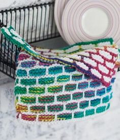Keep kitchen clutter under control with the cheerful Stained Glass Dishcloth. This colorful cloth will add a splash of brightness to your kitchen, and the textured cloth is perfect for scrubbing dishes.