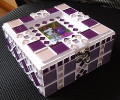 This Box was custom made for a friend. I handmade a glass tile of a photograph which I centred into the sunk lid. I used light purple, dark purple and light pink crystal glass tiles with white grout which I tinted a very light purple.