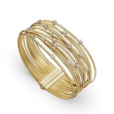 Marco Bicego Goa collection gives a touch of yellow gold for your outfit with this thirteen strand bracelet #MarcoBicego