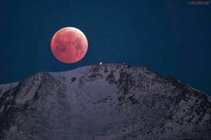 Blood moon on top of pikes peak.