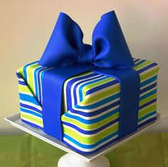 "Such a pretty striped present cake made from modeling chocolate --- looks just like ""wrapping paper""!!  from richard festen of bakingarts"