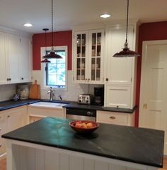 Soapstone countertops, divided farmhouse sink, simple white cabinets, garage door for microwave