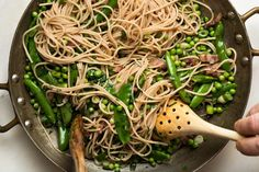 Pasta with peas, a classic combination updated with farro spaghetti, makes for a quick springtime dinner. Spelt Pasta, Pasta With Peas, Pasta Recipes, Green Beans, Grains, Spaghetti, Meals, Dining, Vegetables