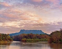 """El Yunque from the Duaba River, 2012    The Duaba River flows on the eastern end of the island with El Yunque mountain in the background.    """"Some pictures have great stories, and some are just the scene is telling the story,"""" Moore says."""