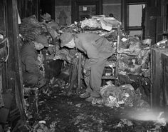 Detectives Joseph Whitmore (l.) and John Laughery look down at the mess inside the Collyer home in 1947. Turns out what they're seeing is actually the body of Langley Collyer. The 61-year-old hermit was found dead in his four-story brownstone under a pile of debris. The brothers had booby trapped their entire home to keep outsiders away, but ultimately Langley fell victim to one of his own tricks.