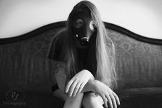 #photography #poses #sitting #couch #gasmask #blackandwhite #b&w #model #longhair