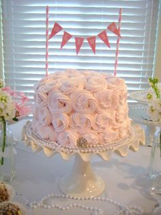 Pink smash cake with bunting - perfect look for a vintage birthday party!