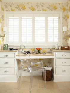 Sunny Style: Livable Touch Flanked by drawers of varying depth to store items of all shapes and sizes, the built-in vanity occupies its own sunny corner. The spacious countertops provide plenty of space for hair dryers, curling irons, and other beauty necessities. As with other counter spaces throughout the room, these have been topped with travertine to ensure the floral wallpaper can maintain its center stage status.