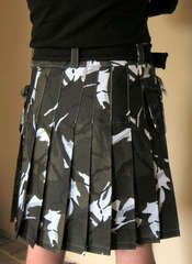 Sew your own kilt.  I made one of these for my husband. . .great tutorial, but had to narrow the pleats a bit