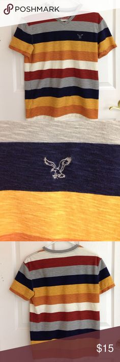 American Eagle V-neck Tshirt American Eagle V-neck T-shirt. Striped. Colors are Navy blue, cream,  pumpkin, gold and gray. Size S . Very small and light spot at collar that is barely noticeable showing in last photo. In very good pre used condition. American Eagle Outfitters Shirts Tees - Short Sleeve