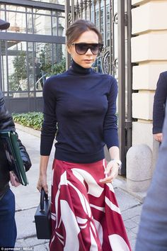 Victoria Beckham retained her stylish reputation as she took to the streets of Madrid, Spain, in another fashion-forward ensemble on Friday.