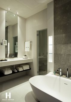 White marble with a background of grey is simply perfect for a hotel bathroom. It gives way for easy pronunciation of the light in the room and with a mirror as big as this makes the room seems much bigger. The deep bath is luxurious and tempting and the sink is of a perfect size and height. With a walk in shower with a rain head and heated towel rails this bathroom could sell a night in the room on it's own.