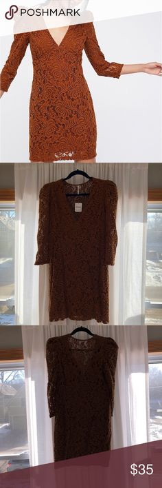 NWT Free People dress Free People laced dress in autumn brown. Fits comfortably for its size of small—not too fitted/tight. 3/4 sleeve. Slip underneath. Free People Dresses Mini