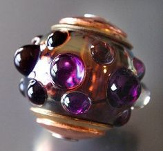 Capped, silvered glass bead. By Jayne LeRette, BadgerBeads