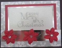 Silver, red and white Christmas card. Greeting stamped and embossed on glitter paper.