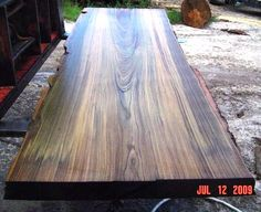 """This is designated for a future indoor table top.  Welcome to Black """"Sinker"""" Cypress.  This slab was cut from one of those really old very large cypress trees found at the bottom of a Florida river.  The wood grain here is fantastic.  This slab is about 3"""" thick, 24"""" wide and 8"""" long.   And it weighs a lot."""