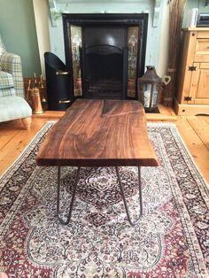 Custom made walnut slab coffee table with cast iron hairpin legs