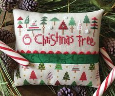 You make 10 counted cross-stitch trees, and then use the printed fabric to supply the rest of the trees. PatternPlus™ for the tiny pillow includes chart and directions, plus 30-ct lambswool linen, two finishing fabrics (for front and back), rickrack