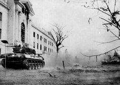 American tanks fire on the Legislature Building from Manila City Hall, Manila, Philippines, Feb. 1945 by John T Pilot, via Flickr