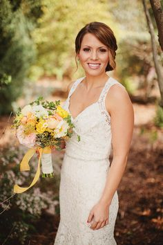 Bride Lauren with her bouquet in Jim Hjelm Blush style number 1104.