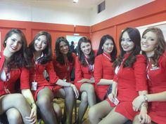 This Christmas, Santa Clause won't be the only one painting the skies red. AirAsia Philippines will also be coming to town with a Red Hot Flight Flight Attendant Hot, Flight Girls, Airline Uniforms, Female Pilot, The Heat, Cabin Crew, Attendance, Beautiful Asian Women, Sexy Legs