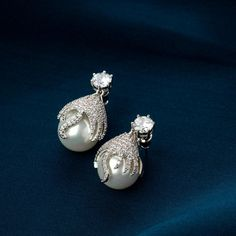 Stunning and unique pearl stud earrings for women and girls. High-quality pearl earrings with swarovski crystals and 18K white gold plating. Swarovski earrings online. Designer Earrings for ethnic and western wear. Buy Earrings, Pearl Stud Earrings, Pearl Studs, Fashion Earrings, Fashion Jewelry, Royal Jewelry, Pearl Jewelry, Jewellery, Artificial Earrings Online