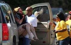 Marcus Arceneaux carries his wounded niece Bethany Arceneaux (left) to a vehicle after she was rescued from a vacant house on Anderson Road on Friday, Nov. 8, 2013, in Duson, La. Leslie Westbrook / Via AP Photo/The Lafayette Daily Advertiser