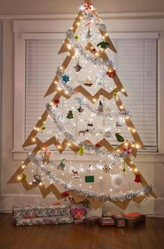 Unconventional tree. Cut from a piece of plywood this tree takes up very little space in the room & to store. Interesting idea.  Great extra tree for hanging ornaments collected over the years, or a themed tree.