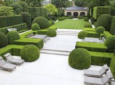 This must be the gardens of an hotel with such a large area of terrace and different places to sit.  Good, well-maintained topiary. #formalgardens #ContemporaryGardenLandscaping