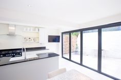 Side Return Extension and Loft Conversion on a Victorian Terraced House in Camden, NW5, Greater London, Bi-fold doors, Velux Roof Lights, Pitched roof, Patio Section, Level Threshold, Kitchen Extension Ideas, Rear Extension, Exterior Doors, Kitchen Extension Doors, Extension Doors