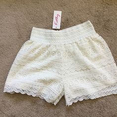 WHITE LACE SHORTS  Very cute white eyelet lace shorts. Available in S/M or L/XL. Tag me with your size! Kathy Shorts
