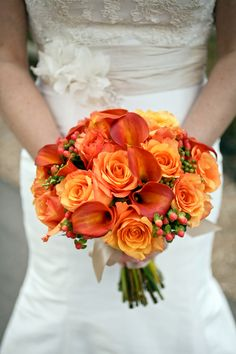 nothing better than a bright color to pop against that beautiful white dress  Orange Calla Lily and Rose Bouquet | photography by http://www.peppernix.com/
