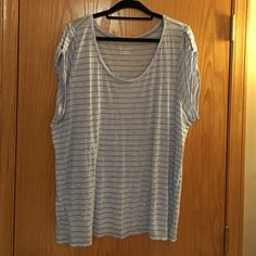 Lane Bryant Top size 26/28 Good condition Lane Bryant short sleeve top. Light blue, size 26/28, 82% rayon, 18% polyester. Lane Bryant Tops