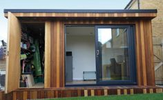 A 4.2m x 2.4m garden office with concealed storage area in Epsom, Surrey. Extras - Canopy roof, small veranda, exterior lighting & internal spotlights. http://www.gardenfortress.com