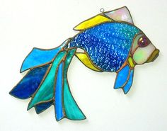 Stained glass decor fish will be a good gift for you and your friends. Suncather made of colored glass Tiffany style.