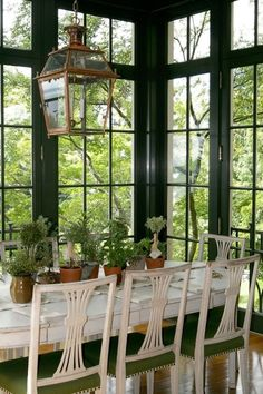 white + #green combined with natural plants and great #lighting in this #DiningRoom