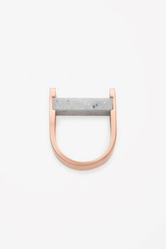 Made from gold-coloured brushed metal this curved ring has a contrasting stone bead. Made from gold-coloured brushed metal this curved ring has a contrasting stone bead. Concrete Jewelry, Stone Jewelry, Stone Beads, Jewelry Art, Jewelry Accessories, Fashion Jewelry, Jewelry Design, Wire Jewelry, Minimal Jewelry