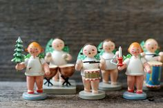 A set of 10 Erzgebirge wooden angel figurines playing different instruments. Made in Germany with their original stickers intact, except 4.