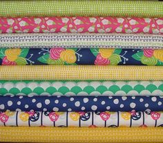 9 Fat Quarters of Gleeful. These are high quality designer quilting fabrics cut from the bolt. Each cut is 18x 20/22 totaling 2 1/4 yards.
