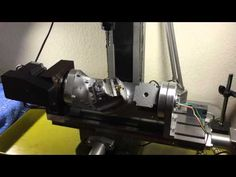 Self made 5 axis rotary table for my Proxxon FF500CNC machine - YouTube