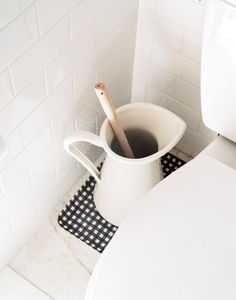 Everyone needs a toilet brush, but it doesn't have to be an eyesore. Check out this clever hack for more attractive toilet brush storage. Photograph by Matthew Williams for Remodelista: The Organized Home. Rustic Bathroom Decor, Bathroom Styling, Bathroom Organization, Bathroom Storage, Bathroom Faucets, Bathroom Vinyl, Bathroom Mirrors, Storage Organization, 50s Bathroom